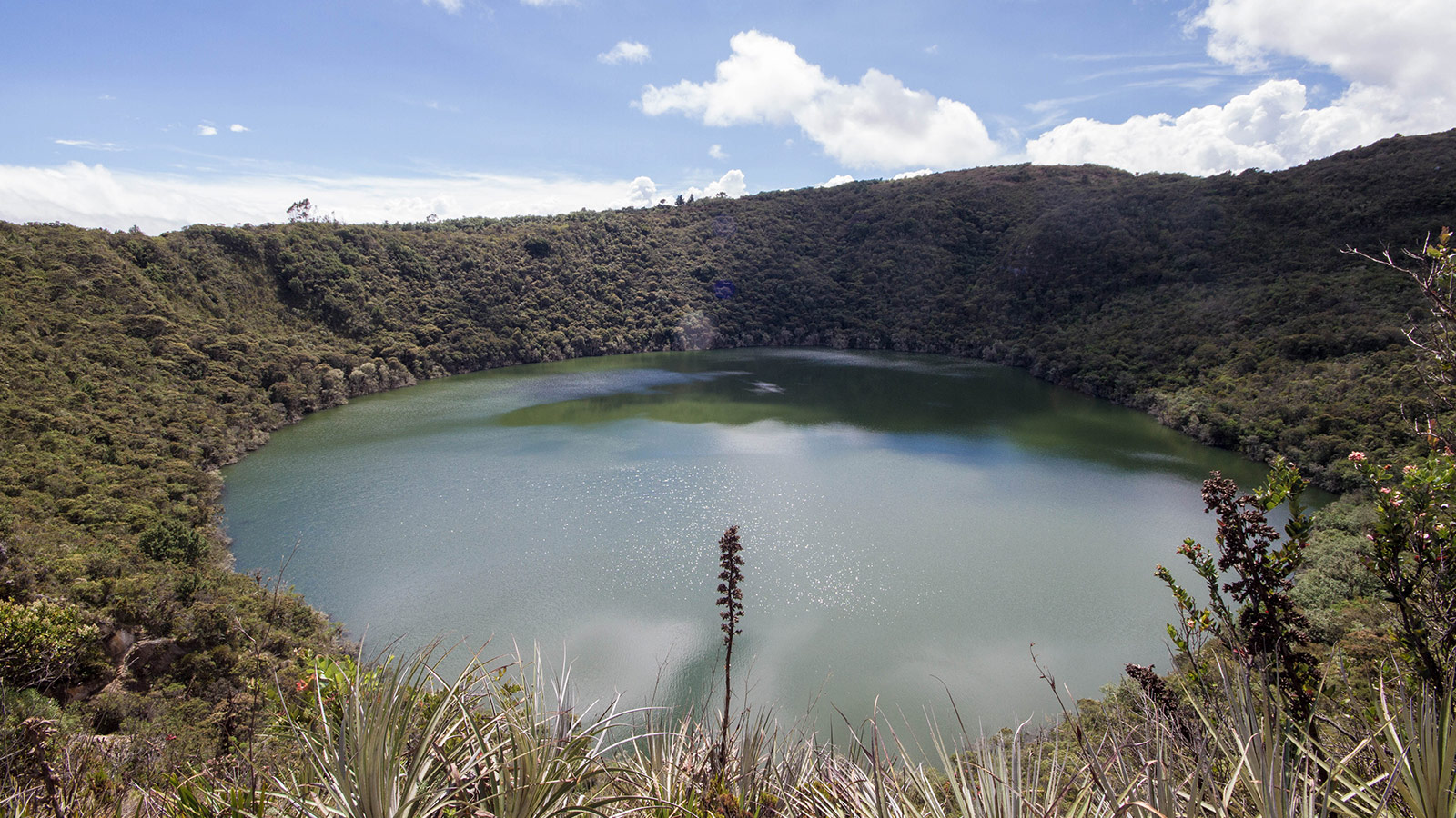 A crater lake surrounded by jungle that is believed to be part of the Lost City of Gold in Guatavita Colombia with Kids