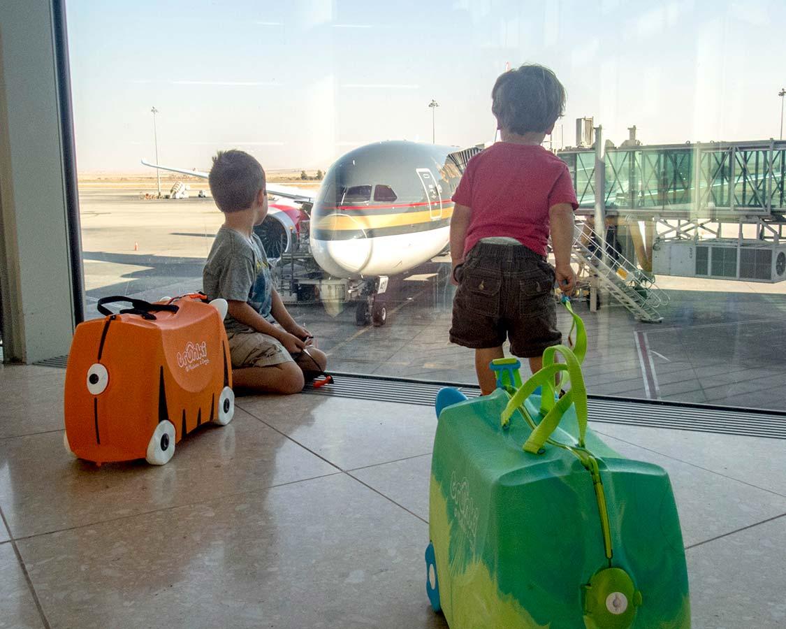Children watch a Royal Jordanian airplane in Amman Jordan