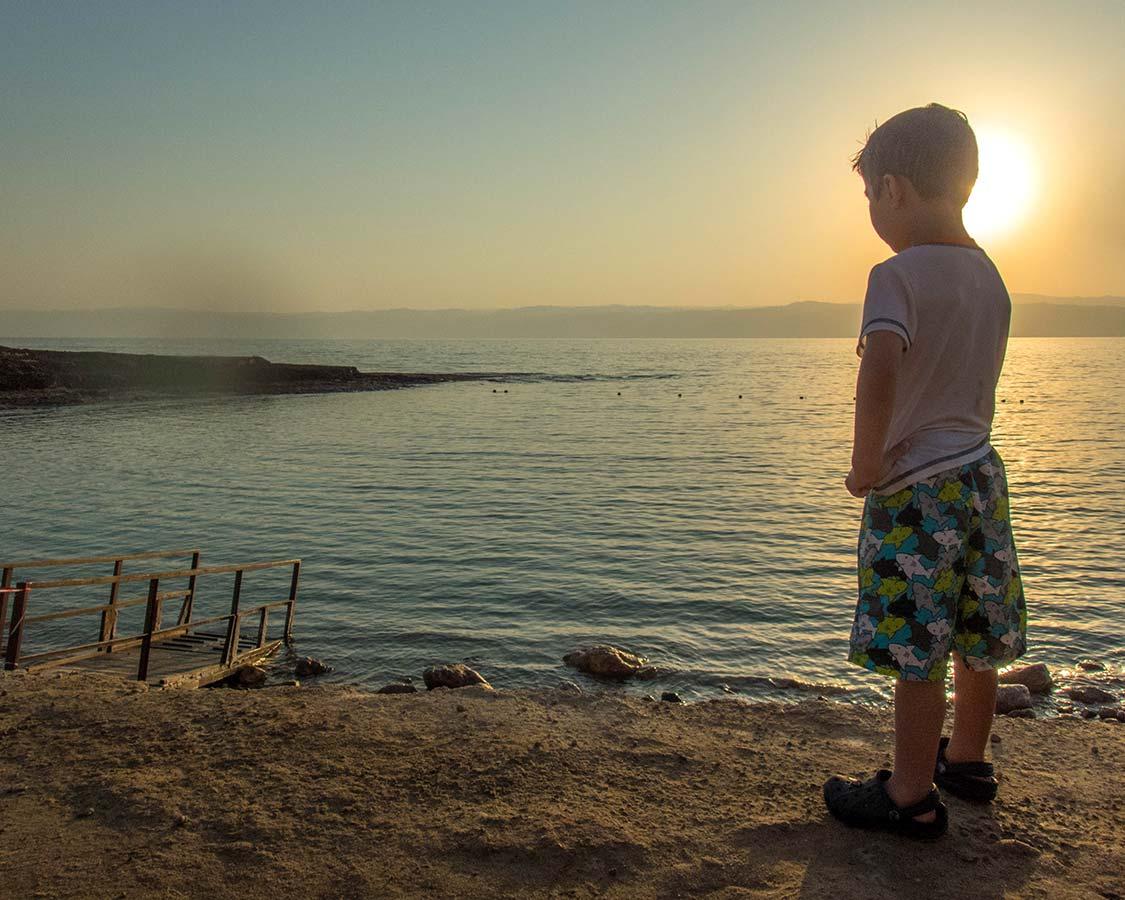 Boy looks at the Dead Sea in Jordan