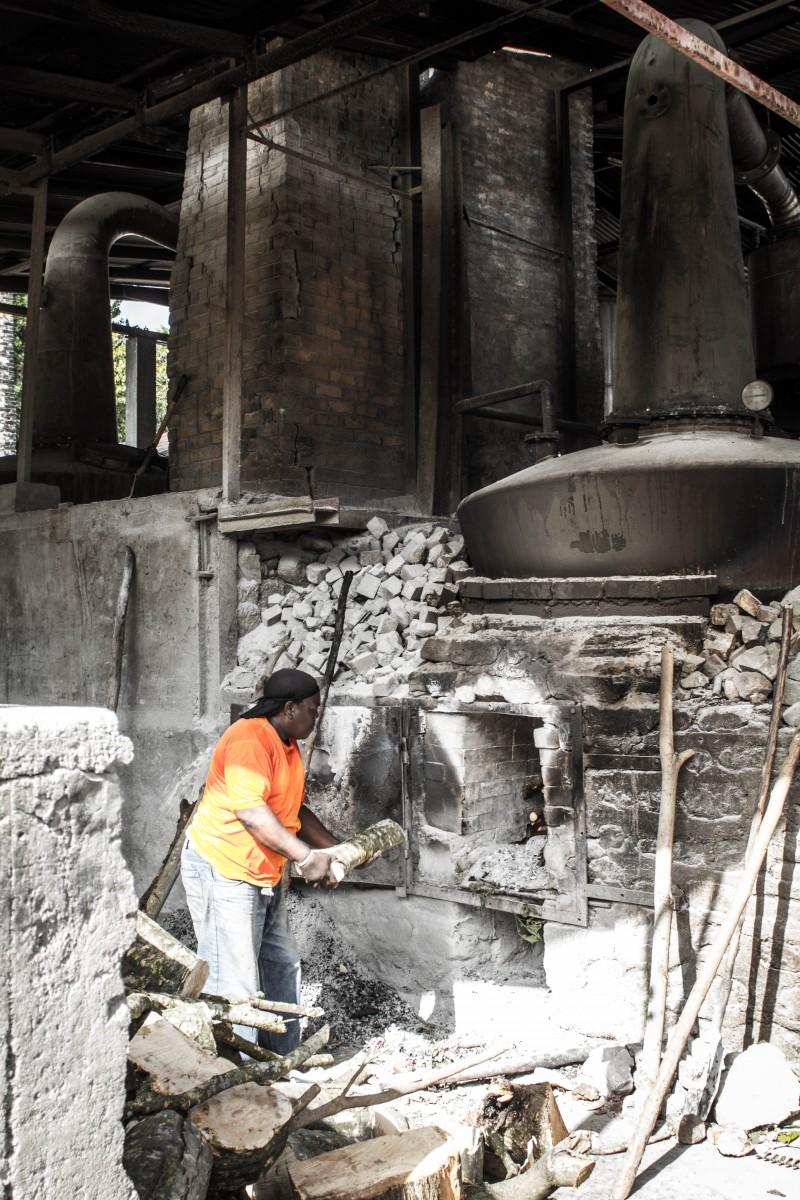 Grenada Tour - Rum Distillery worker