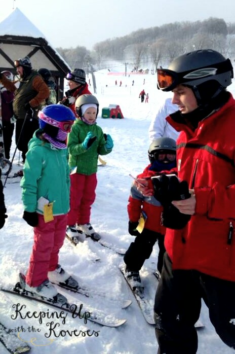 Girl gets ski lesson from an instructor - Skiing North Michigan