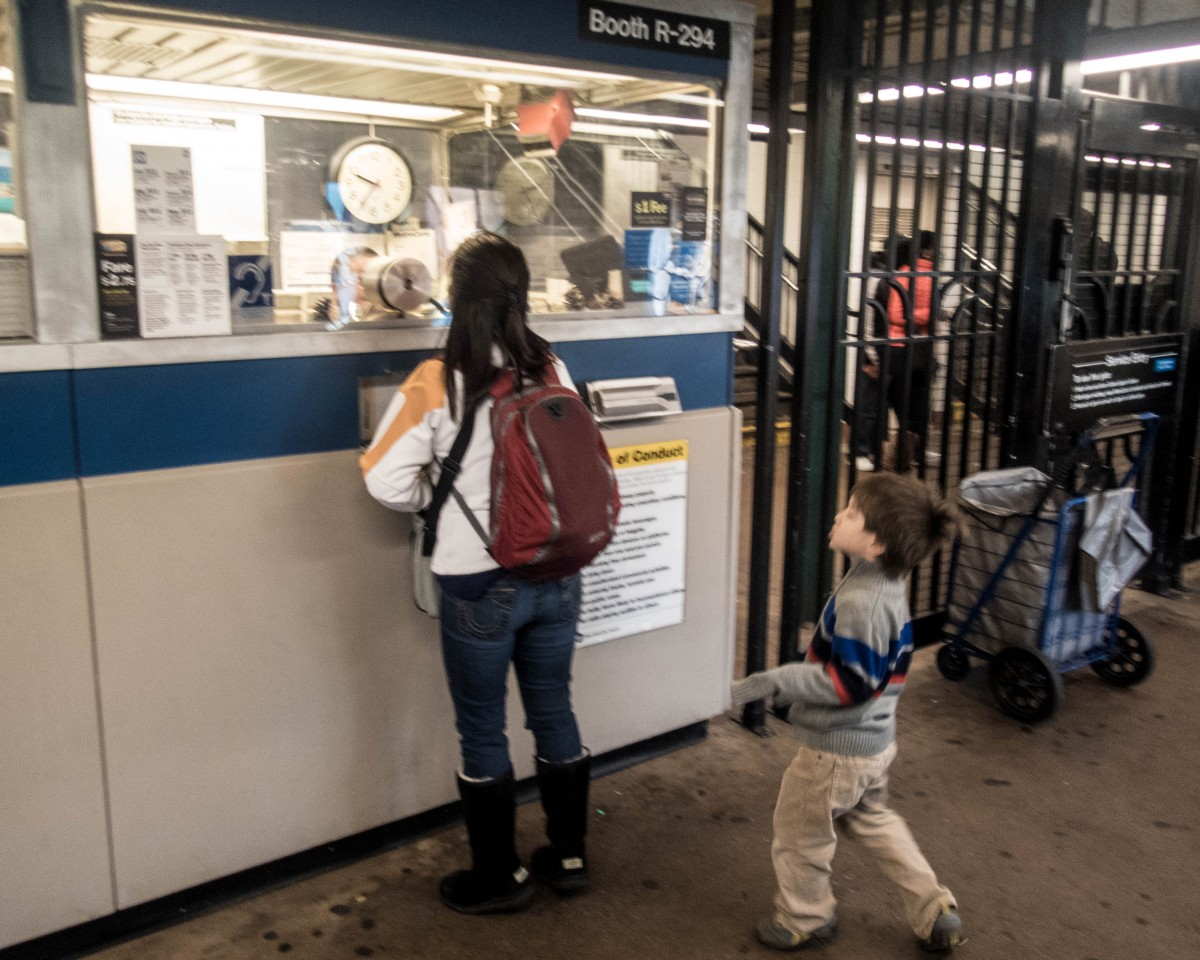 woman and children at subway ticket counter