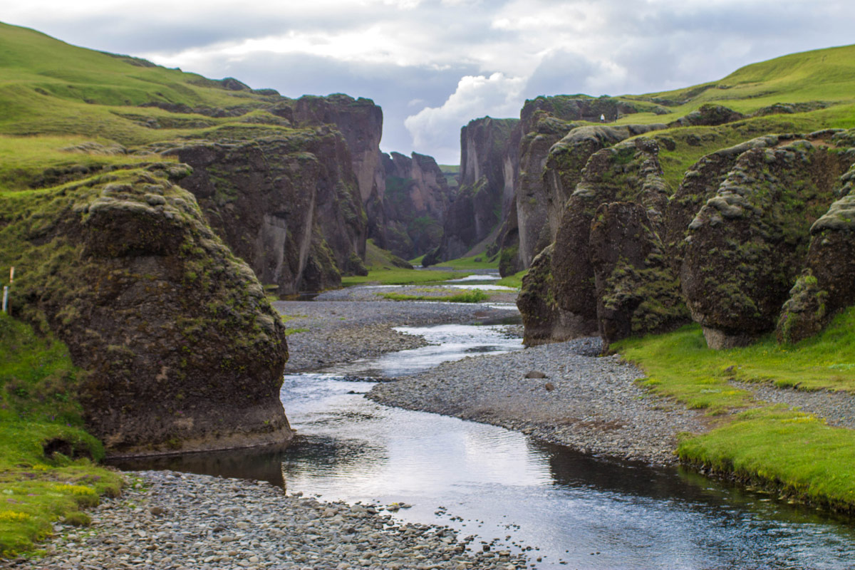 A small canyon with a lazy river and green topped cliffs - An Epic 14 Day Iceland Itinerary