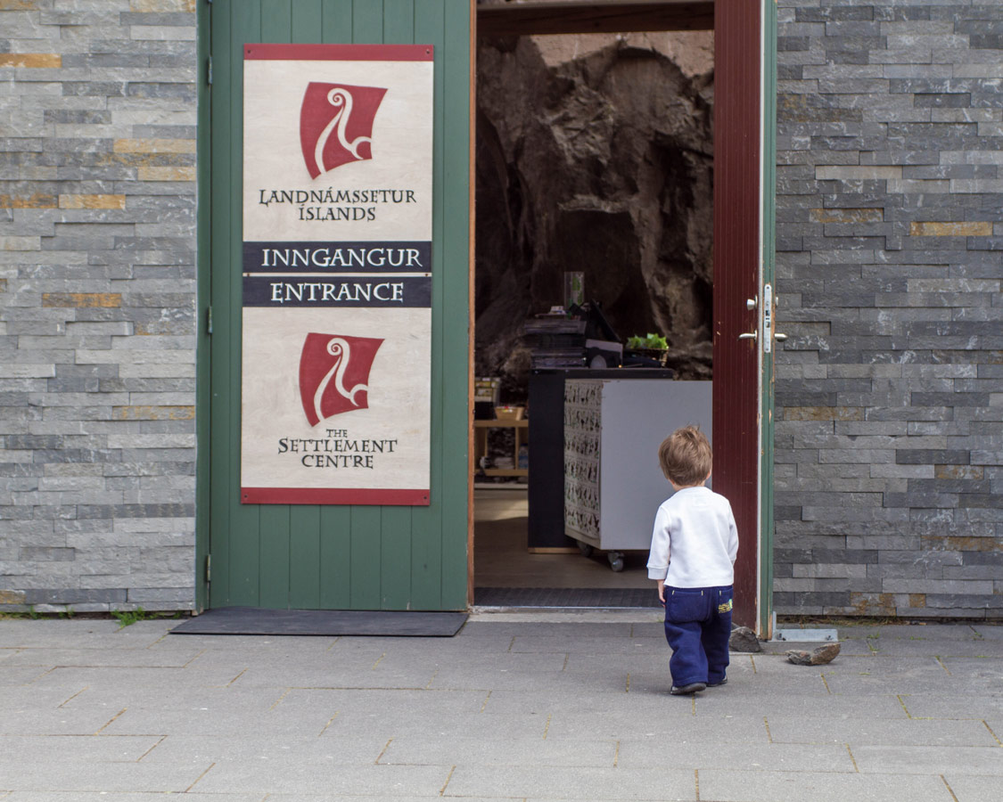 A young boy peeks into an Icelandic museum - Epic 14 Day Iceland Itinerary