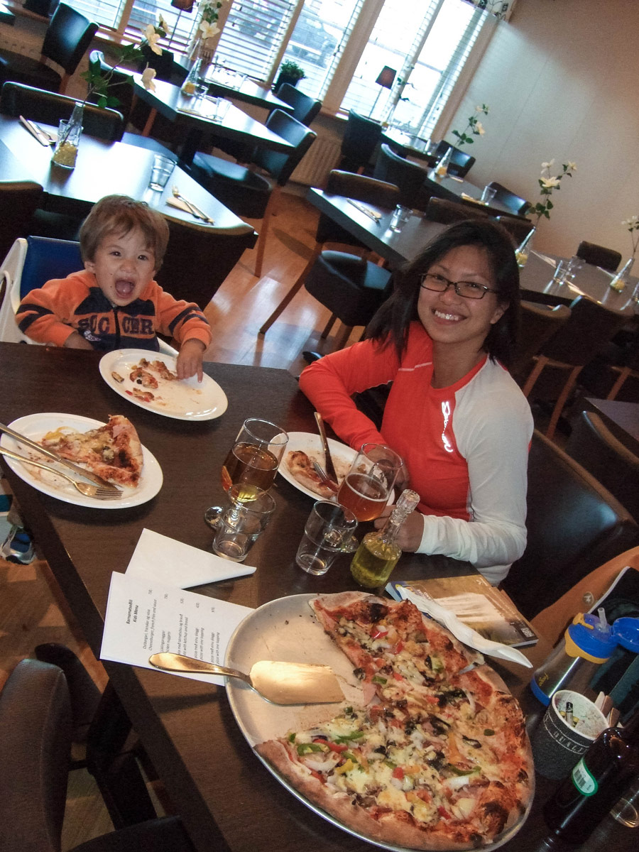 A mother and young boy smile while eating Pizza - An Epic 14 Day Iceland Itinerary