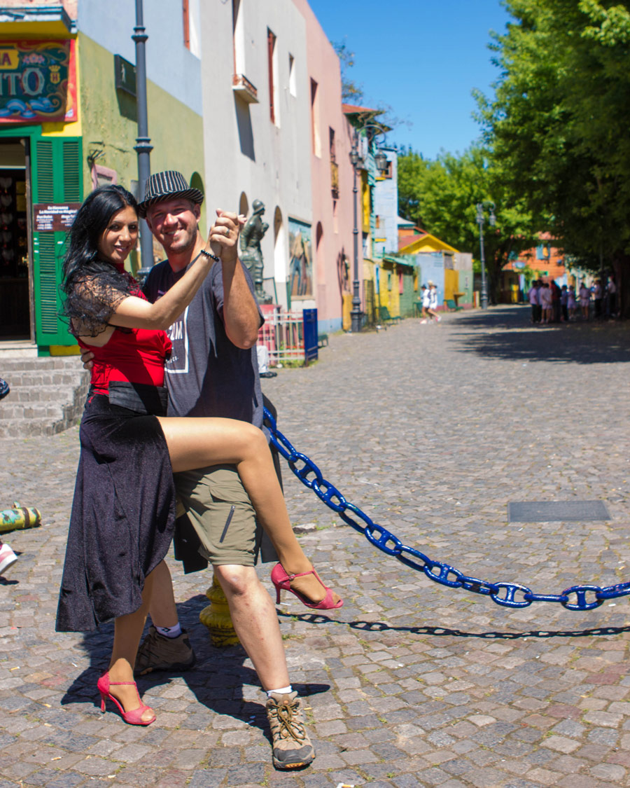 Man poses with a Tango performer in La Boca, Buenos Aires.