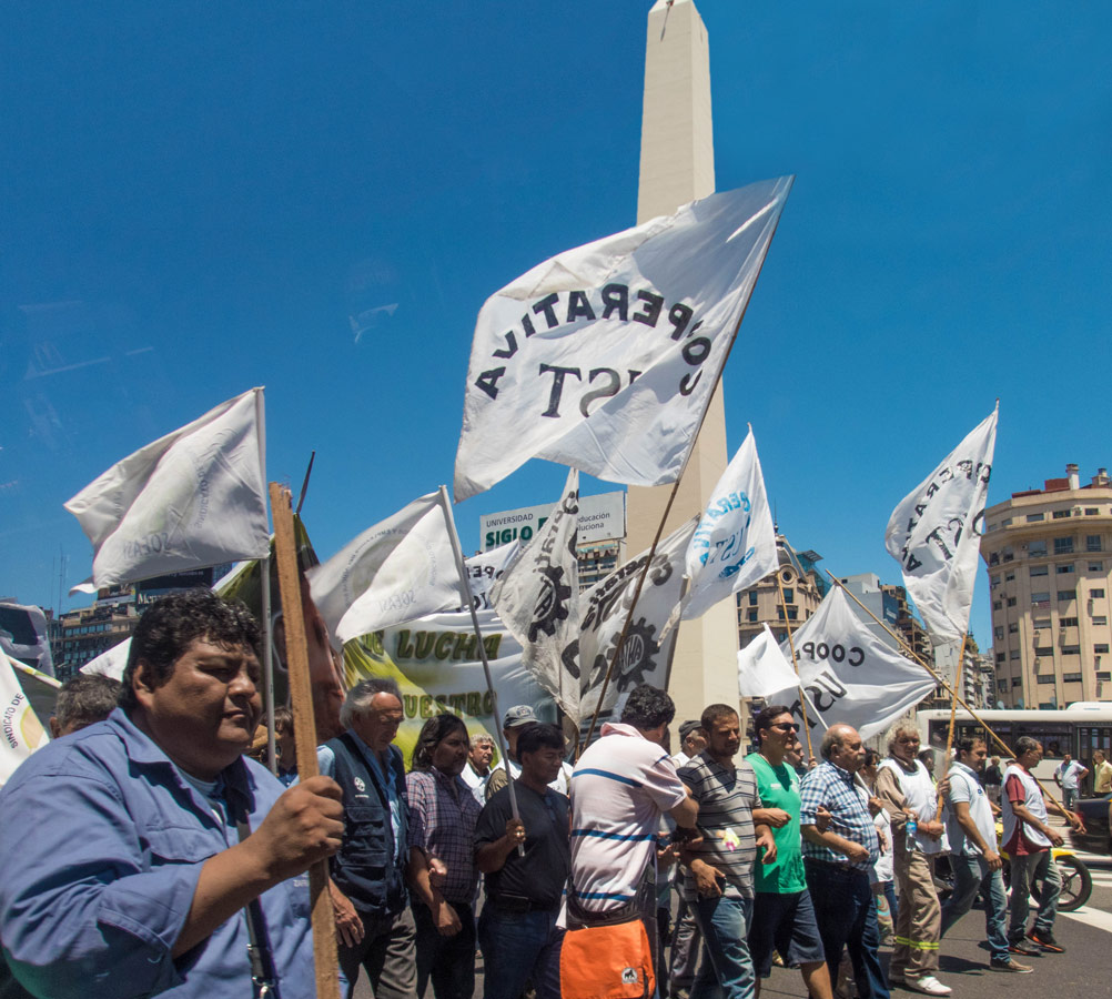 Protestors passing by the Obelisk in Retiro district of Buenos Aires.