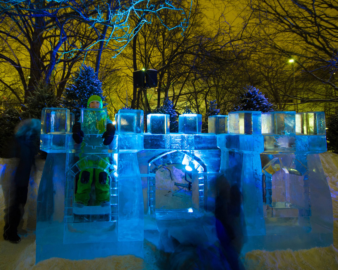 Boy playing in Ice castle is one of the best ways to enjoy Winterlude with kids.