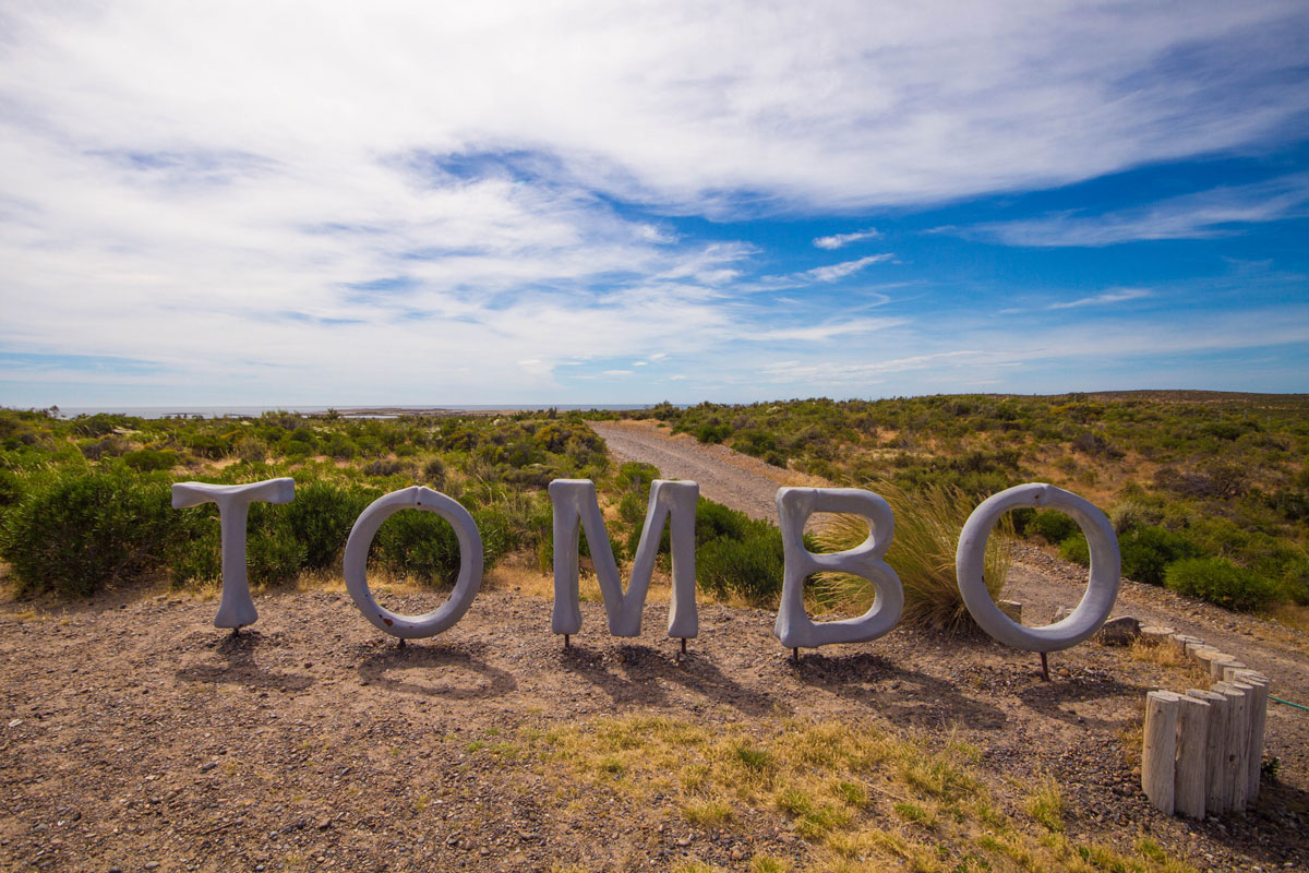 A wooden sign saying Tombo at the Punta Tombo Penguin Conservation Area