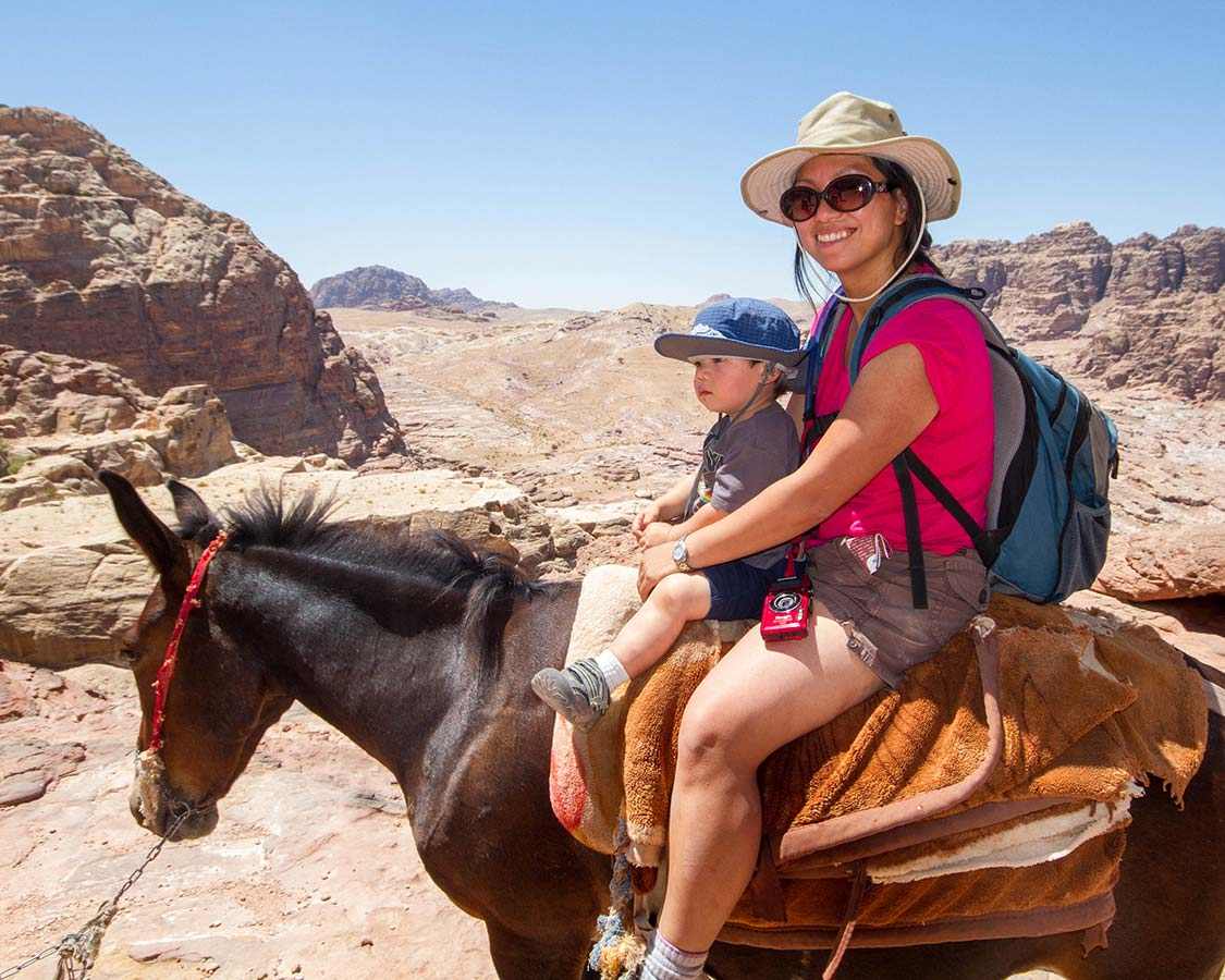 Petra with children Christina Wagar rides a donkey in Petra with her son