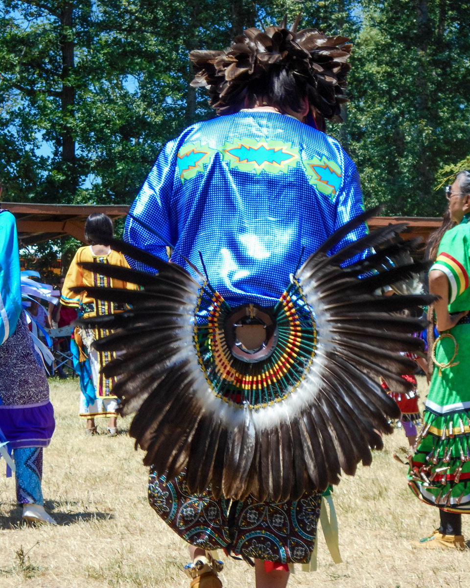 A dancer with an eagle feather tail at a Pow Wow in Ontario