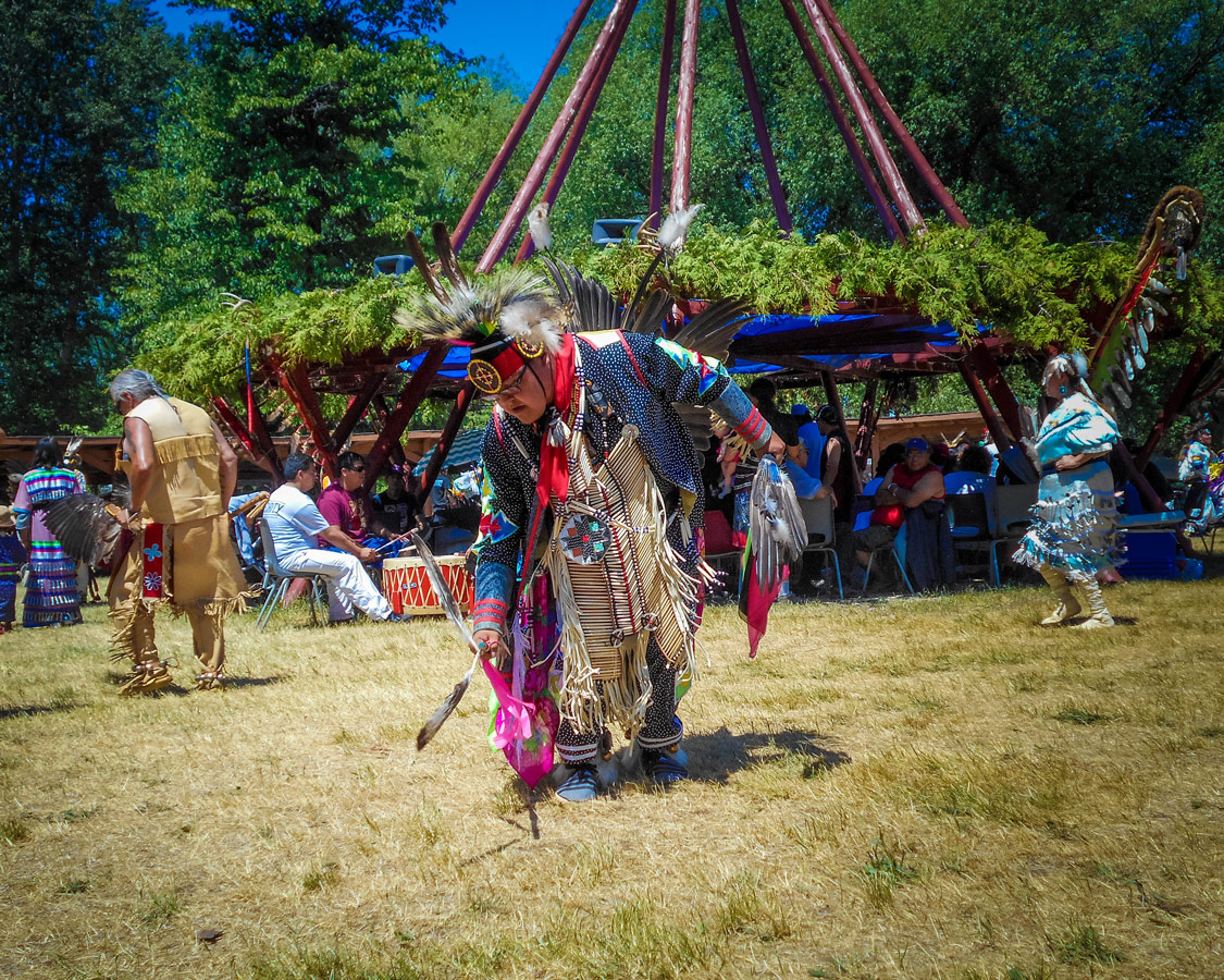 A Native elder dances at a First Nations Pow Wow
