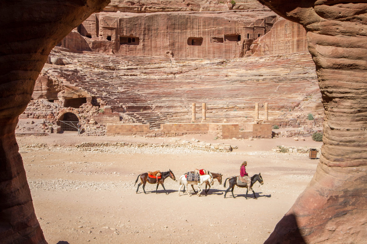Petra with children A Bedouin guiding horses strolls in front of the theater as seen from the house across the wadi