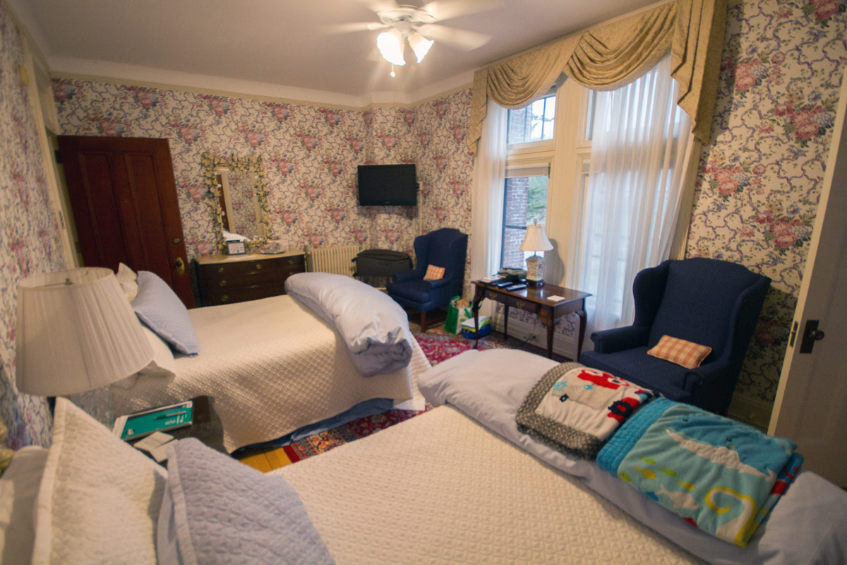 Bedroom at the Wilburton Inn with two double beds and walk-in closet.