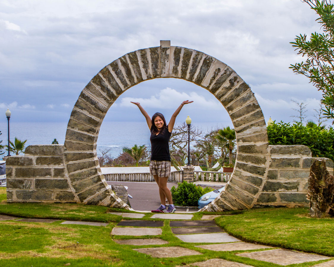 Christina shows off one of the beautiful Moongates in Bermuda