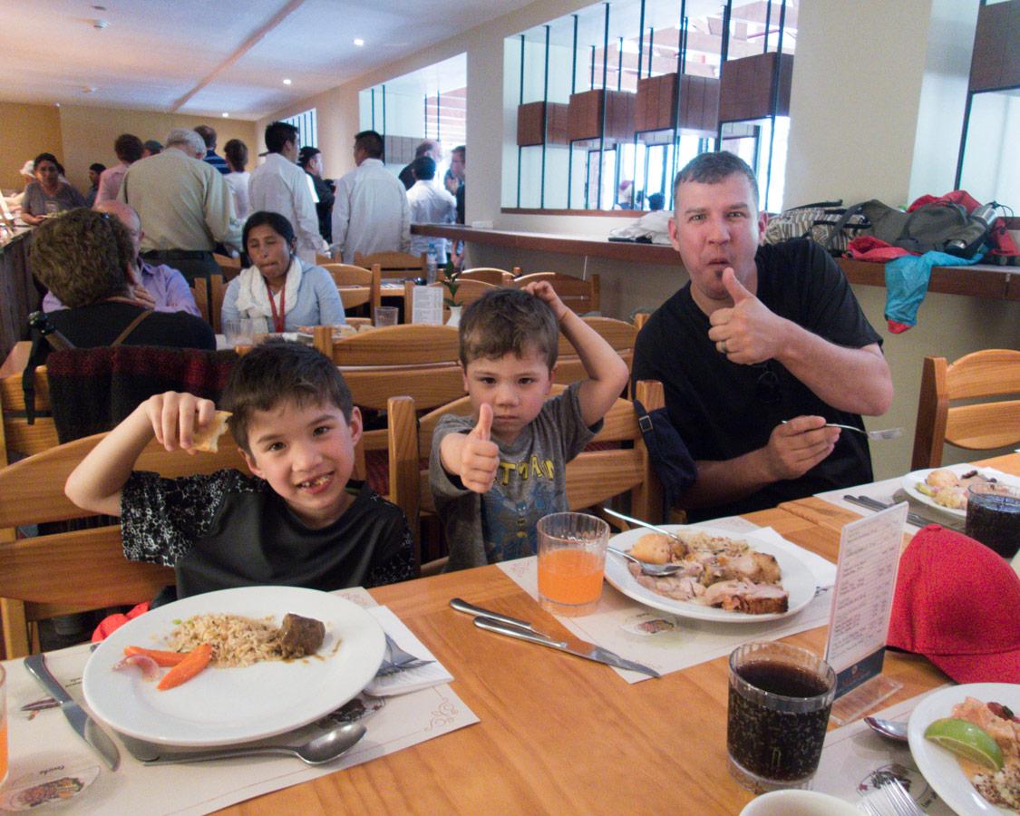 Machu Picchu travel kids - Family having lunch at the Belmond Lodge Sanctuary Restaurant.
