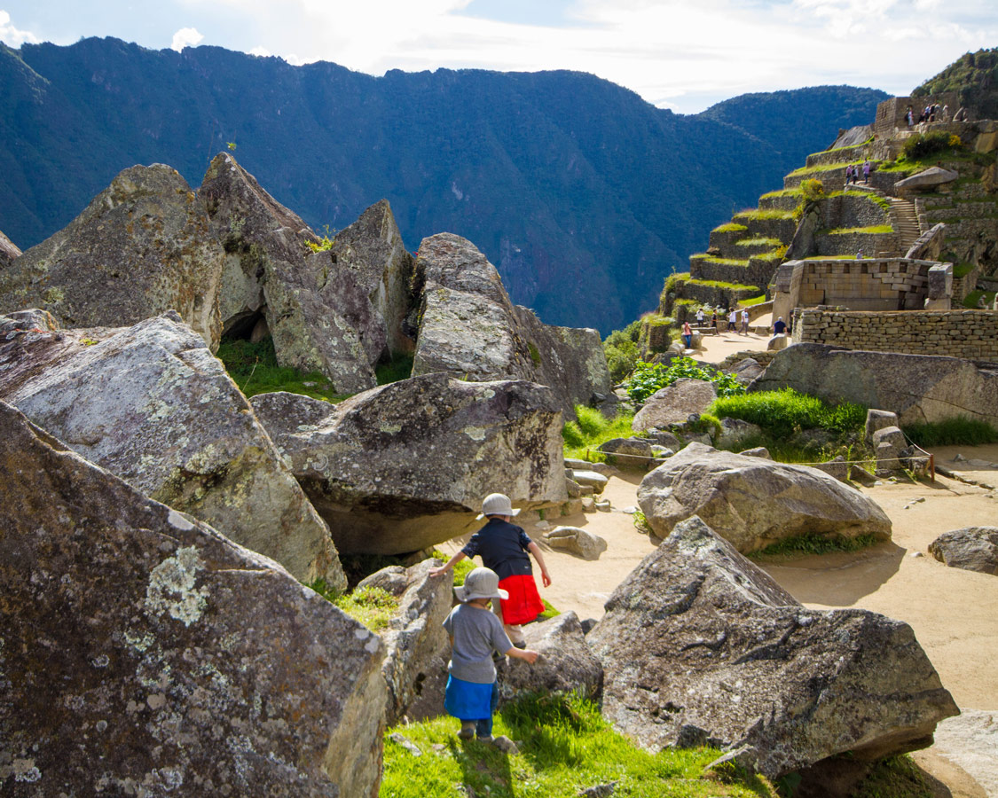 Machu Picchu with children - boys heading to the Quarry in the urban sector of Machu Picchu.