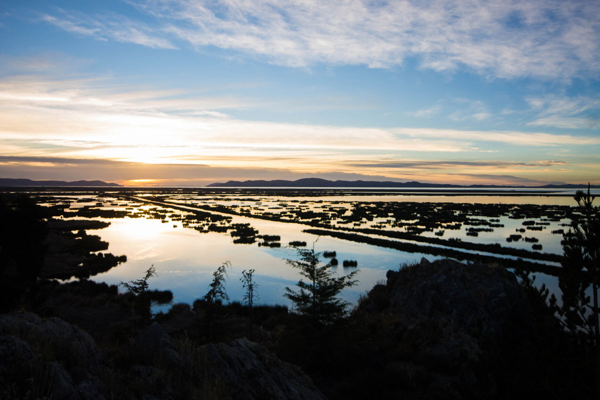 Sunrise over Lake Titicaca in Peru. A wonderful sight to see while visiting Lake Titicaca with Kids