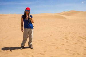 About us Family travel expert Christina Wagar in the Huacachina Desert of Peru