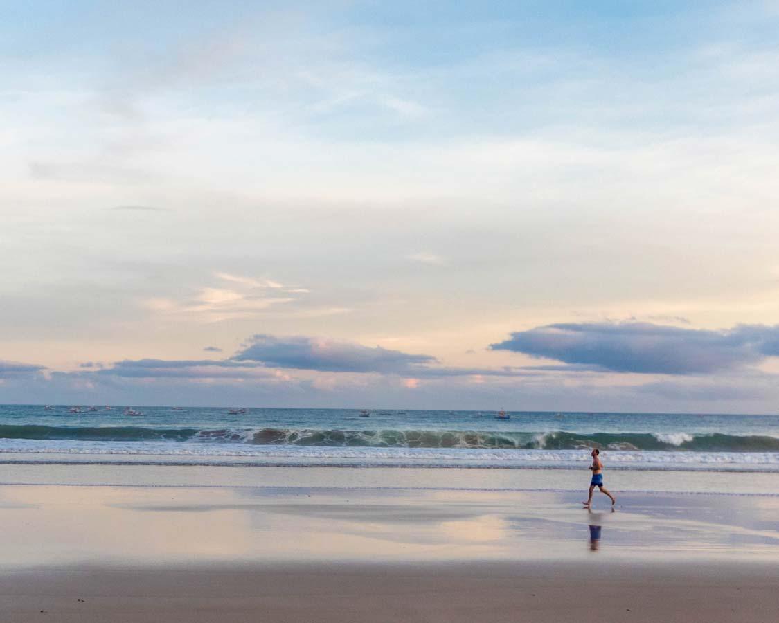 Jogger o the Sabang beach near Daluyon hotel in Puerto Princesa Philippines