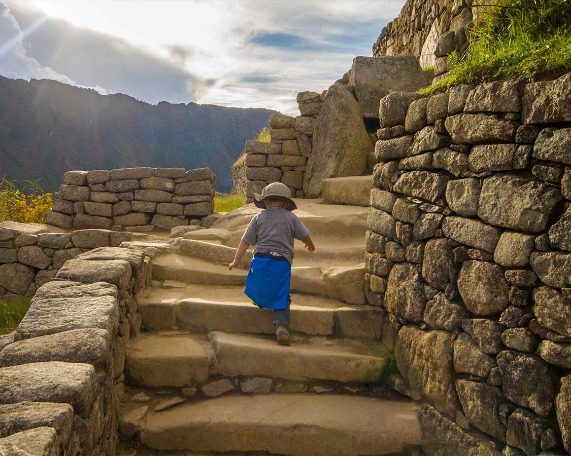 Boy climbing Machu Picchu